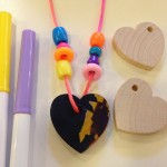 Stringing wooden hearts