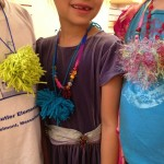 Making pom poms for necklaces, key rings, backpack clips...