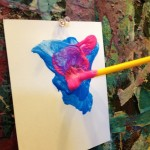 Paintbrushes at the easel wall