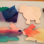 Coloring springtime shapes with bleeding tissue paper
