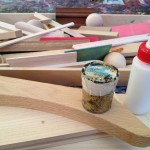 Glue, wood, fabric, and glitter creations