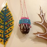 Acorn jewelry and decorated leaves