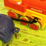 Painting with cars, trucks, and trains