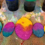 Mixing liquid watercolor onto egg shapes