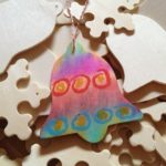 Wooden ornaments colored with tissue paper