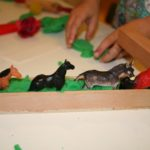 Green play dough and animals