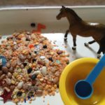 Rice and beans at the sensory table