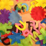 Paper letter and fabric flower collage