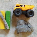 Clay, tools, and construction vehicles